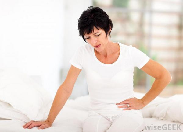 woman-winces-at-pain-in-abdomen