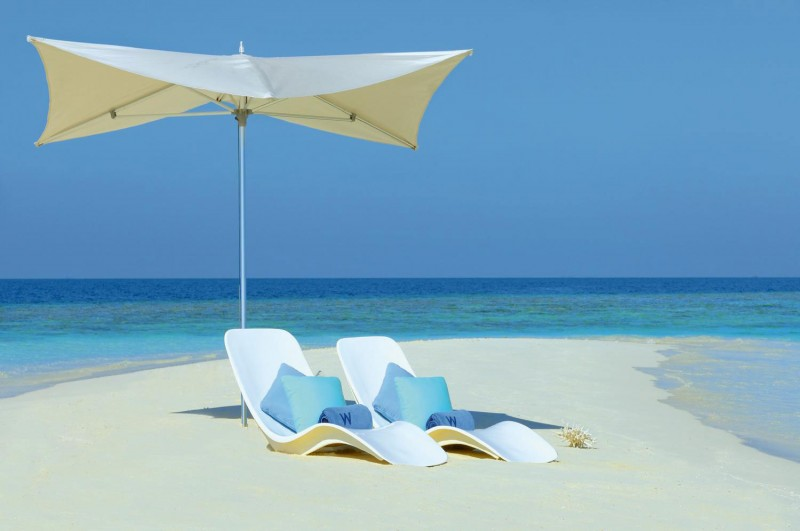 White-Sun-Bath-Chairs-With-Cushion-Beach-Umbrella-White-Sand-Ocean-View